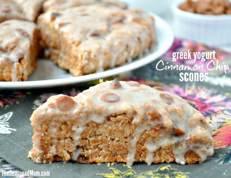 A close up of cinnamon chip scones drizzled with a greek yogurt glaze