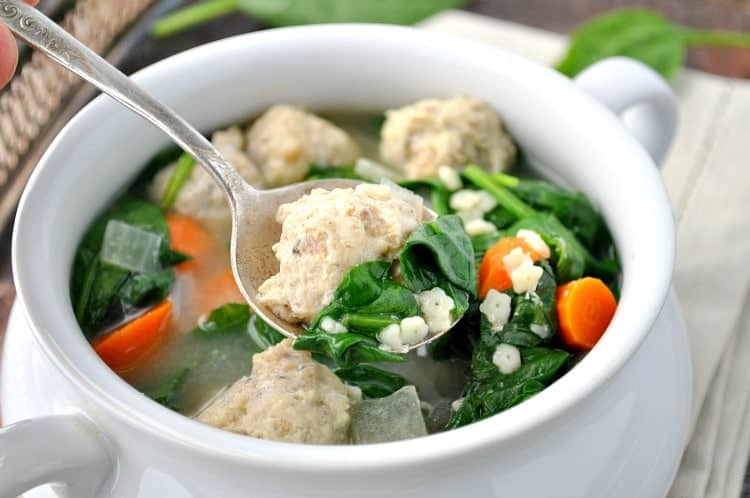 A close up of a spoonful of Italian wedding soup