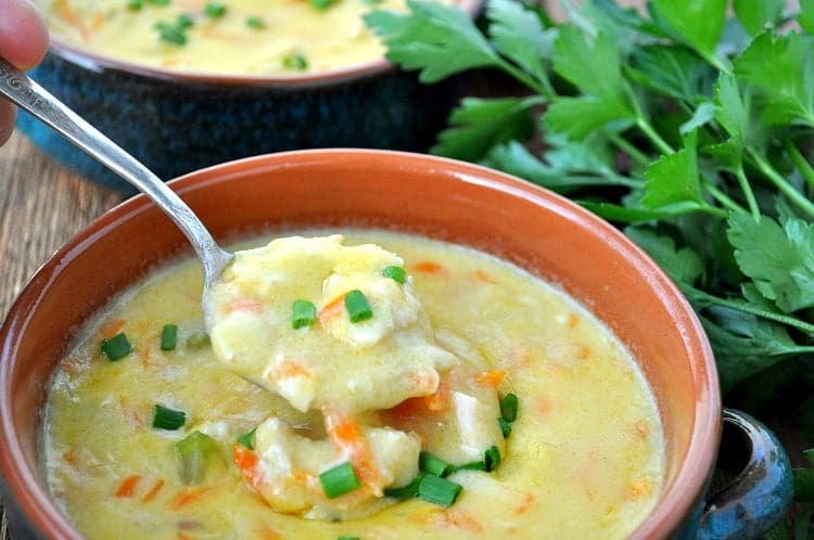A spoonful of chicken chowder with cheese