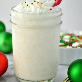 A jar filled with a frosted sugar cookie protein shake
