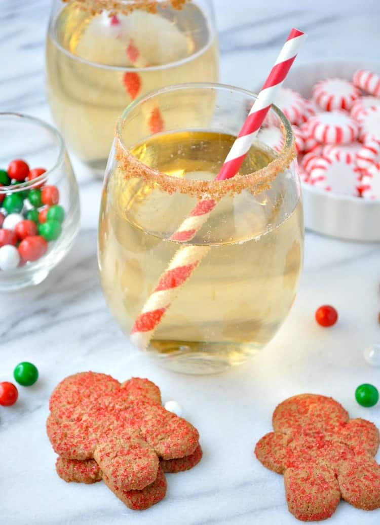 This Gingerbread Cookie Champagne Spritzer is a fun, festive, and tasty cocktail for a Christmas Cookie Exchange, for a happy hour with the girls, or for a holiday cocktail party.