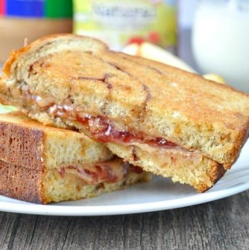 A grilled peanut butter and jelly sandwich on a plate