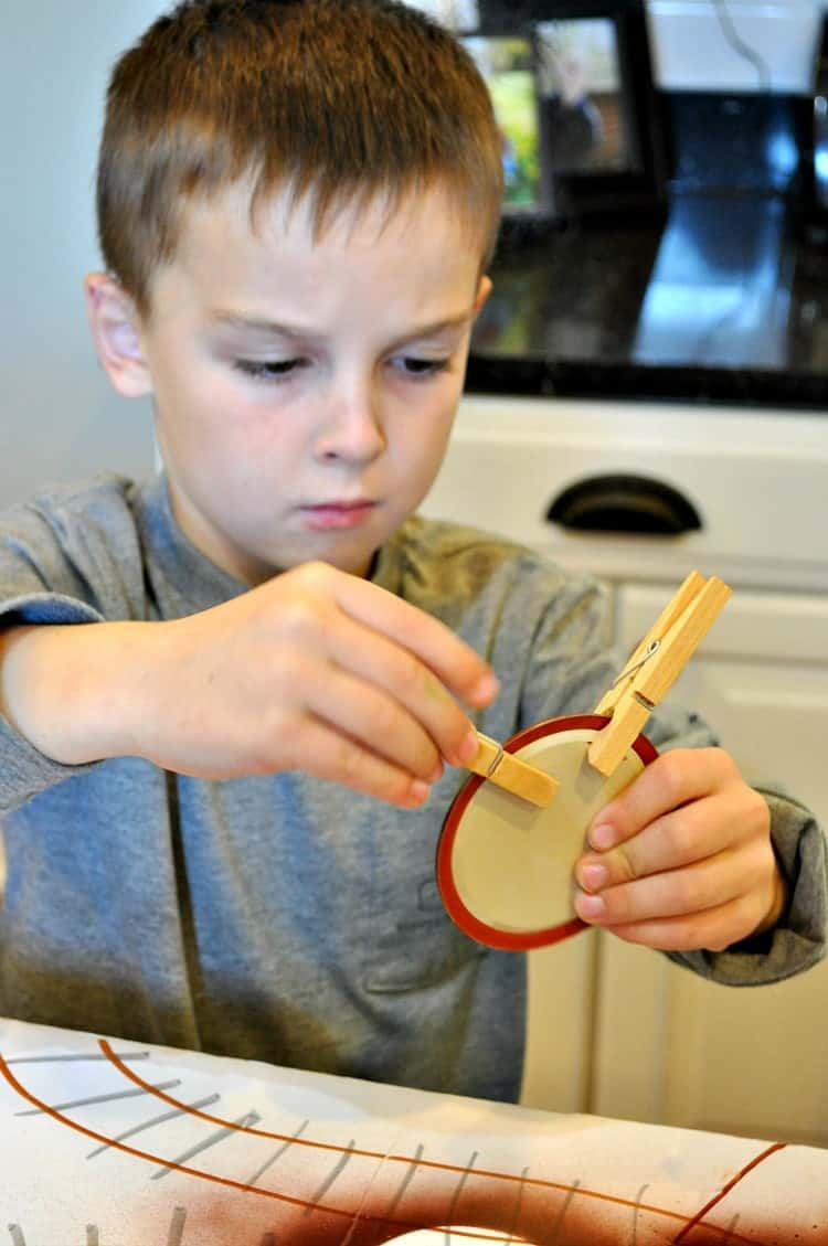 Clipping antlers on homemade reindeer christmas ornaments