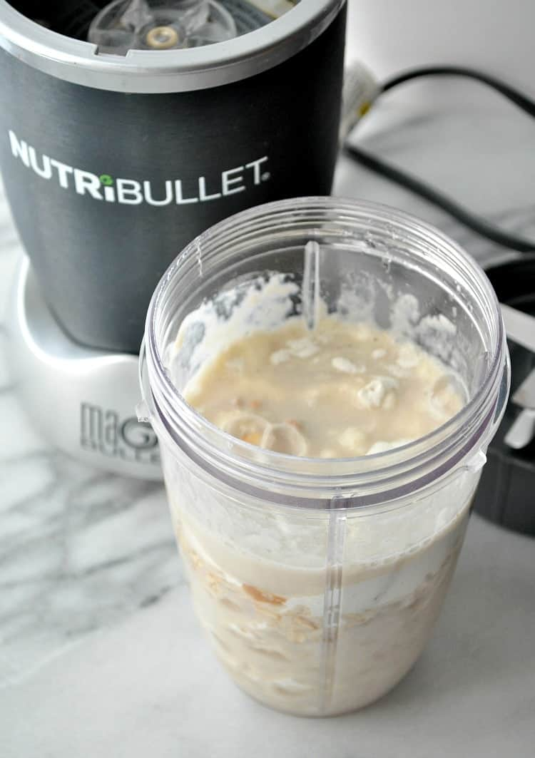 A frosted sugar cookie protein shake in a nutri bullet after blending