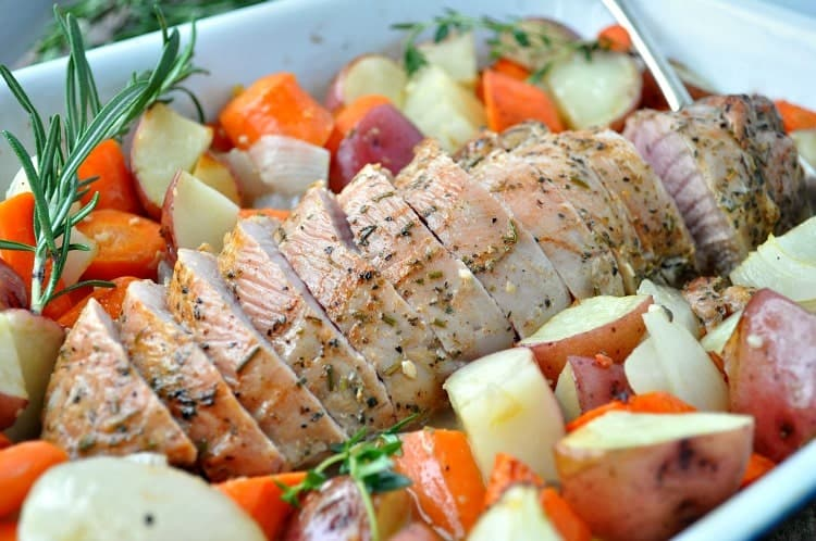 With only 10 minutes of prep you can pop this One Dish Garlic & Herb Pork Tenderloin into the oven for an easy dinner!