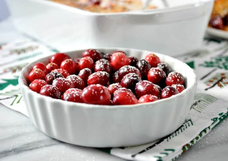 A dish filled with cranberries for making an overnight French Toast Casserole