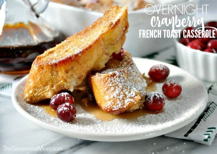 Two slices of overnight french toast on a plate with cranberries