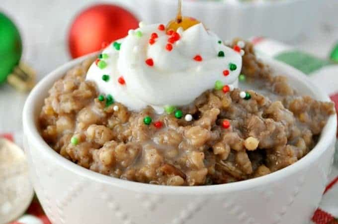 A close up of slow cooker oatmeal in a white bowl