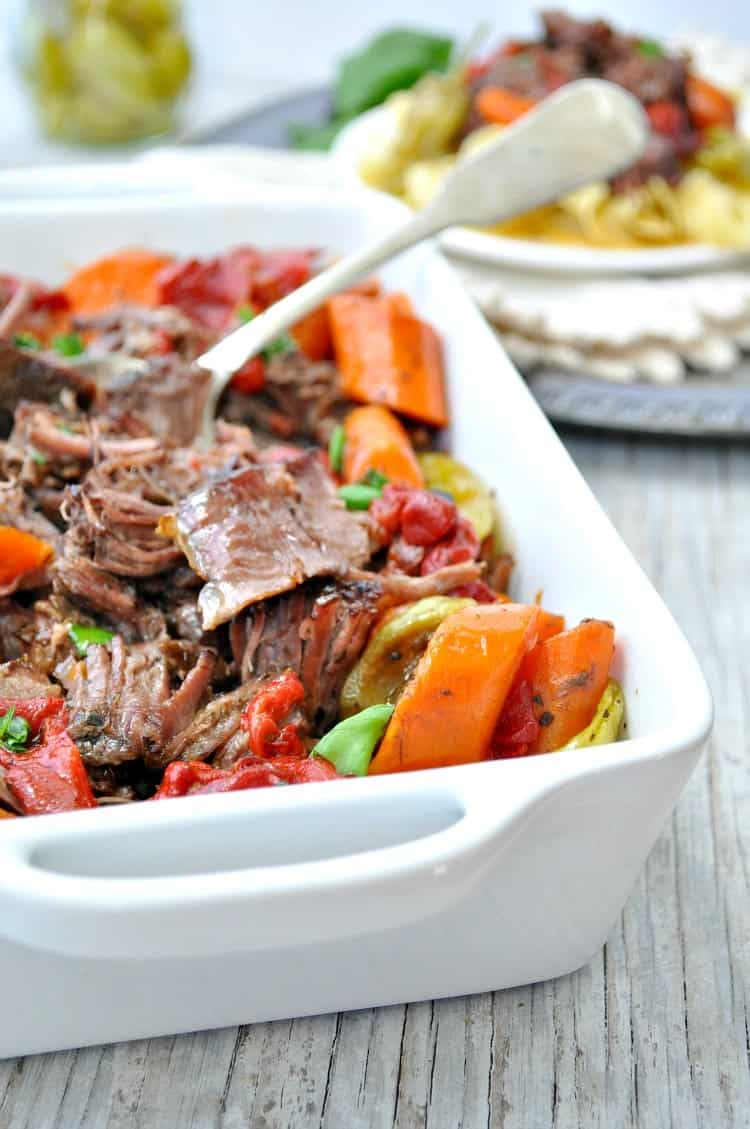 Tender, juicy, melt-in-your-mouth Slow Cooker Italian Pot Roast is an easy dinner recipe that the whole family will love!