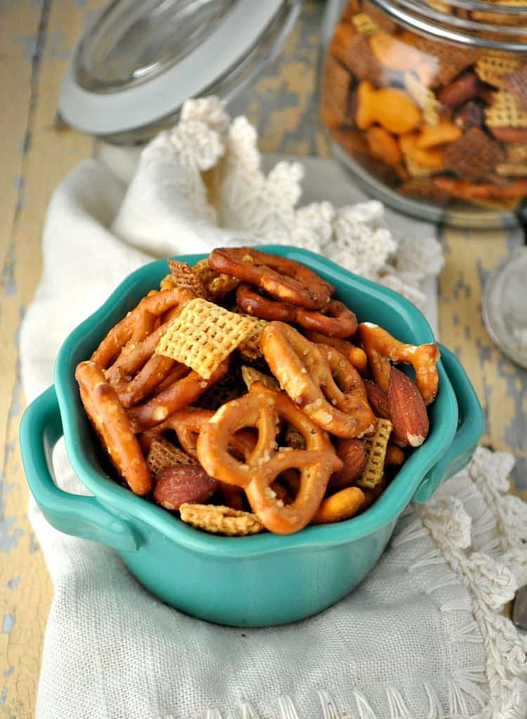 This Slow Cooker Mesquite Smokehouse Snack Mix is a salty, crunchy, and spicy easy appetizer for game day gatherings and festive holiday parties!