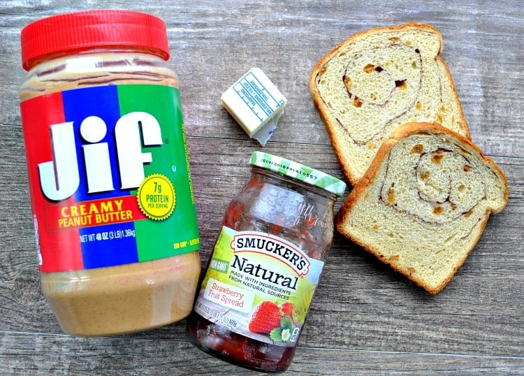 An overhead shot of ingredients to make a peanut butter and jelly sandwich