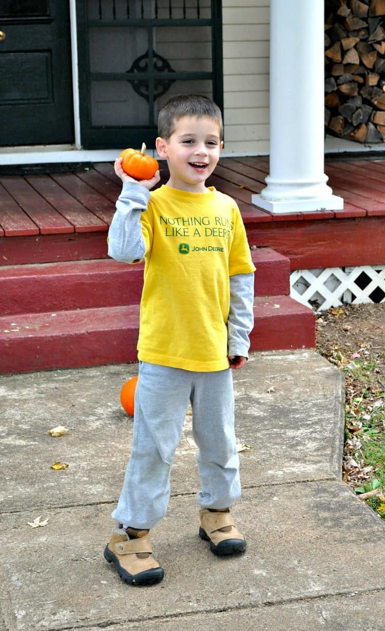 Child playing turkey bowling game on Thanksgiving