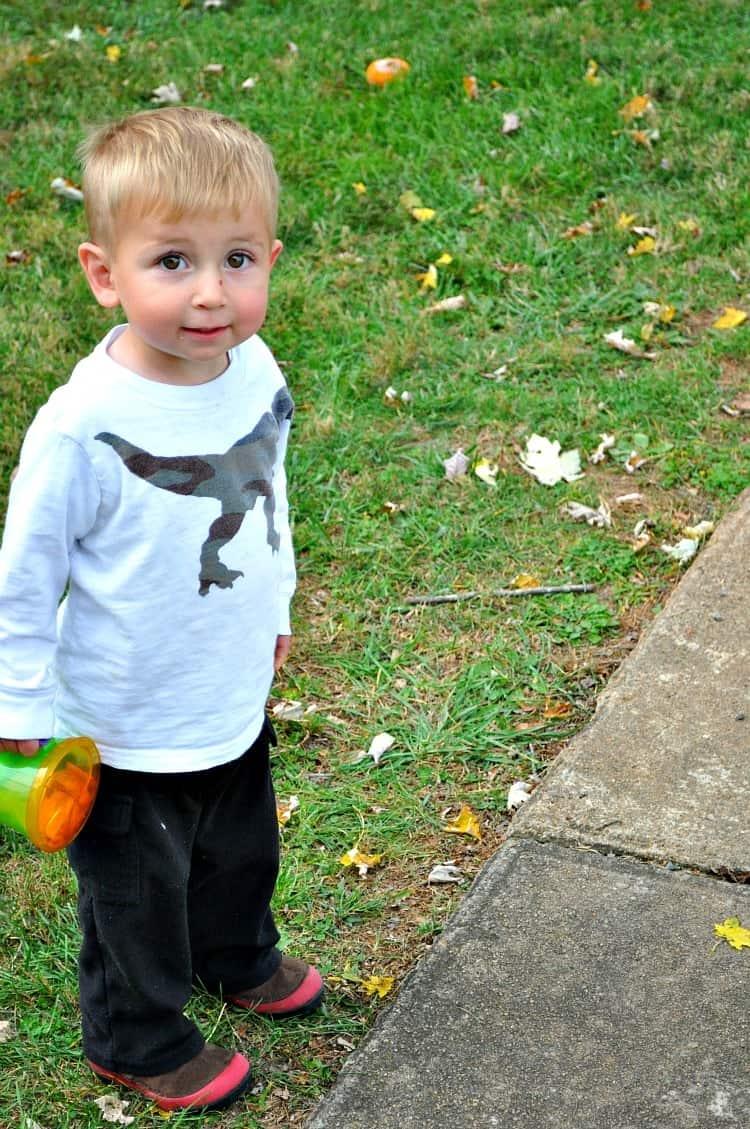 Child holding snacks outside
