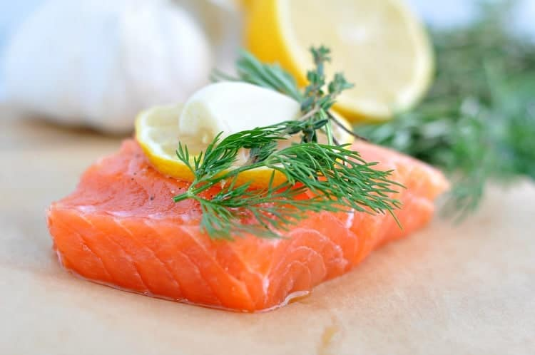 Salmon fillet topped with herbs, garlic and lemon