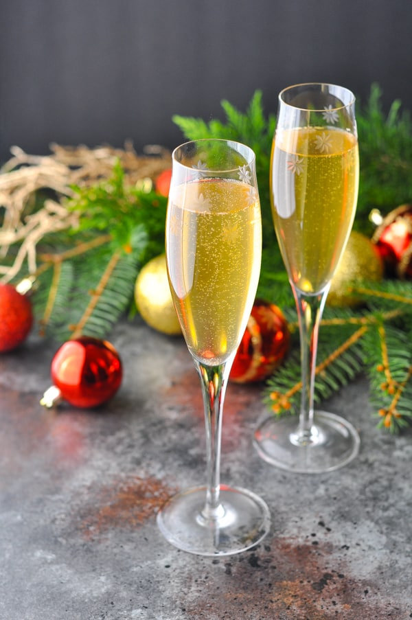 Champagne Cocktail in flutes with holiday decorations