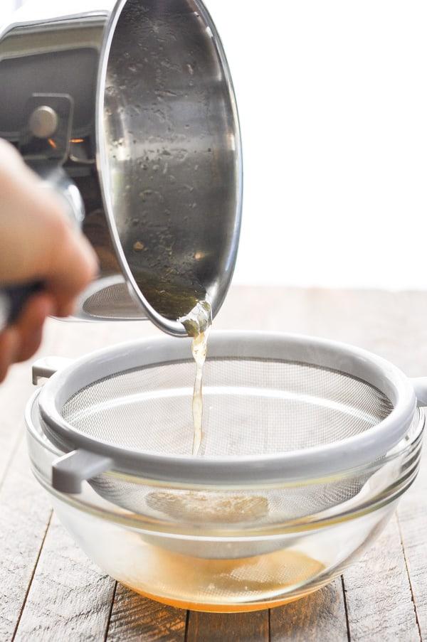 Straining syrup through sieve
