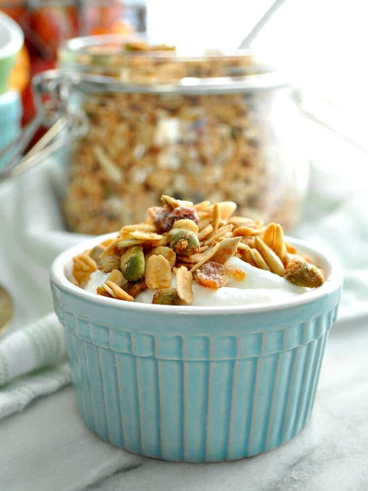 A close up of maple almond crunch granola in a small blue bowl
