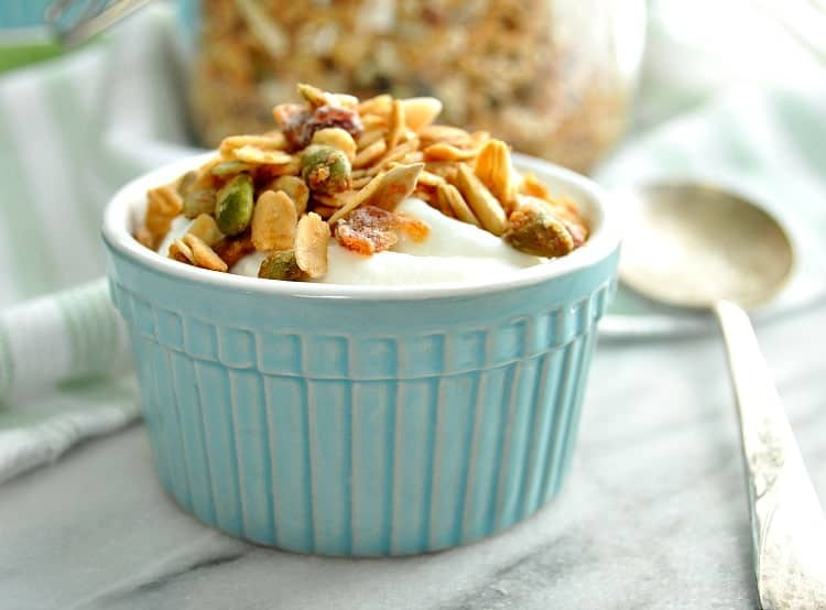 A close up of a small bowl filled with maple almond crunch granola