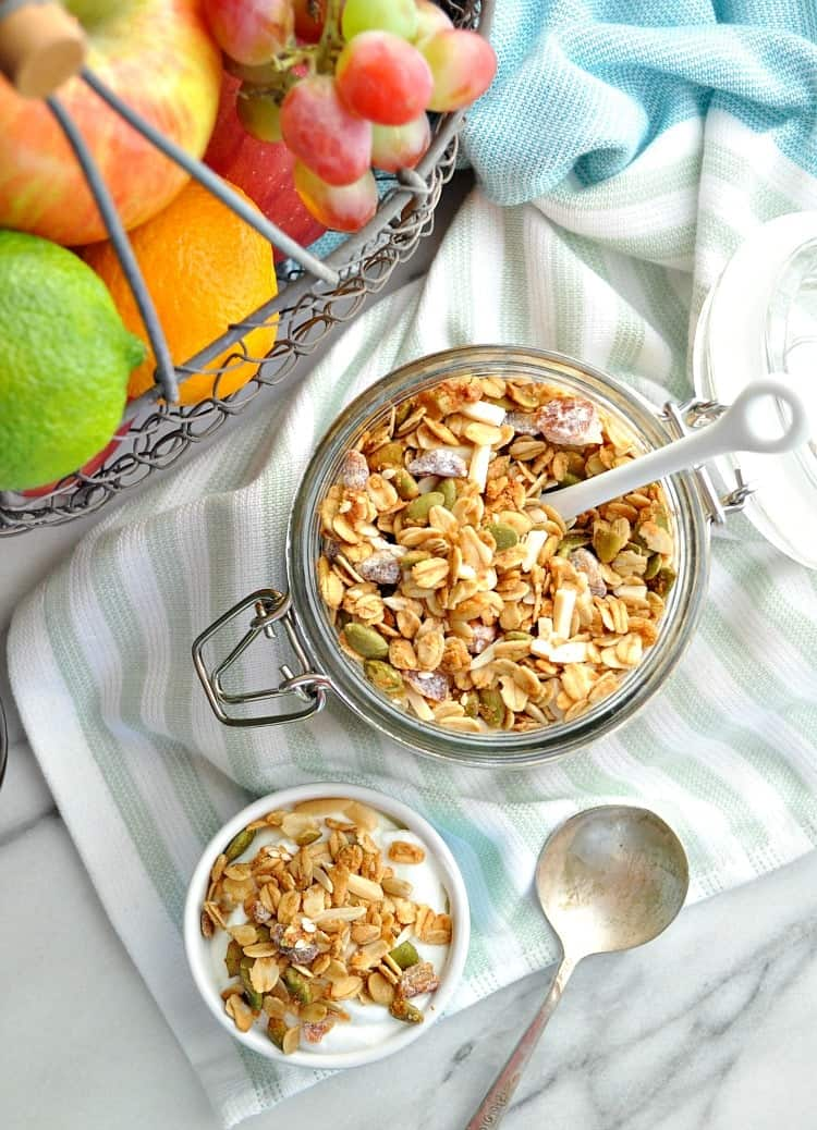 An overhead shot of granola in a jar and in a small bowl