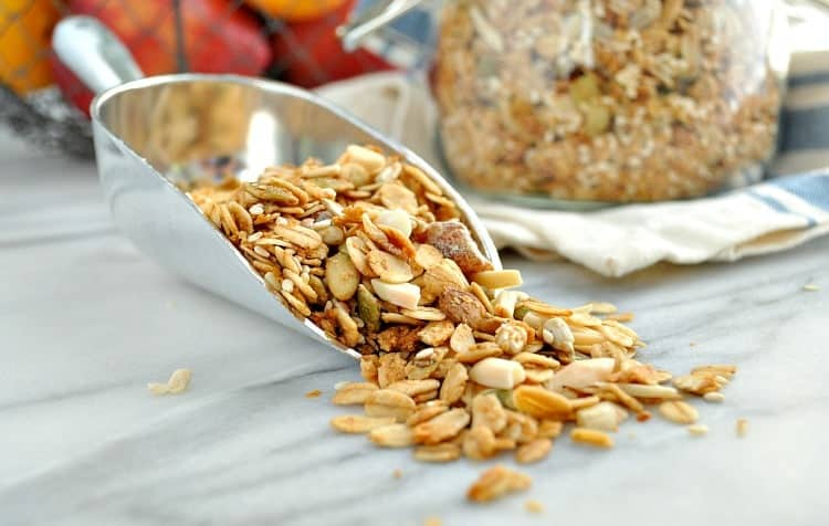 A photo a maple almond crunch granola in a scooper
