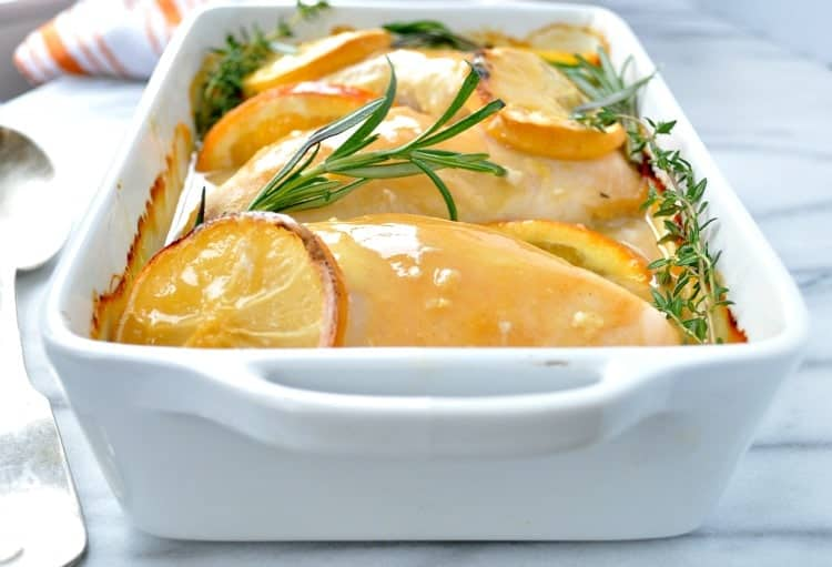 A close up of citrus and herb baked chicken