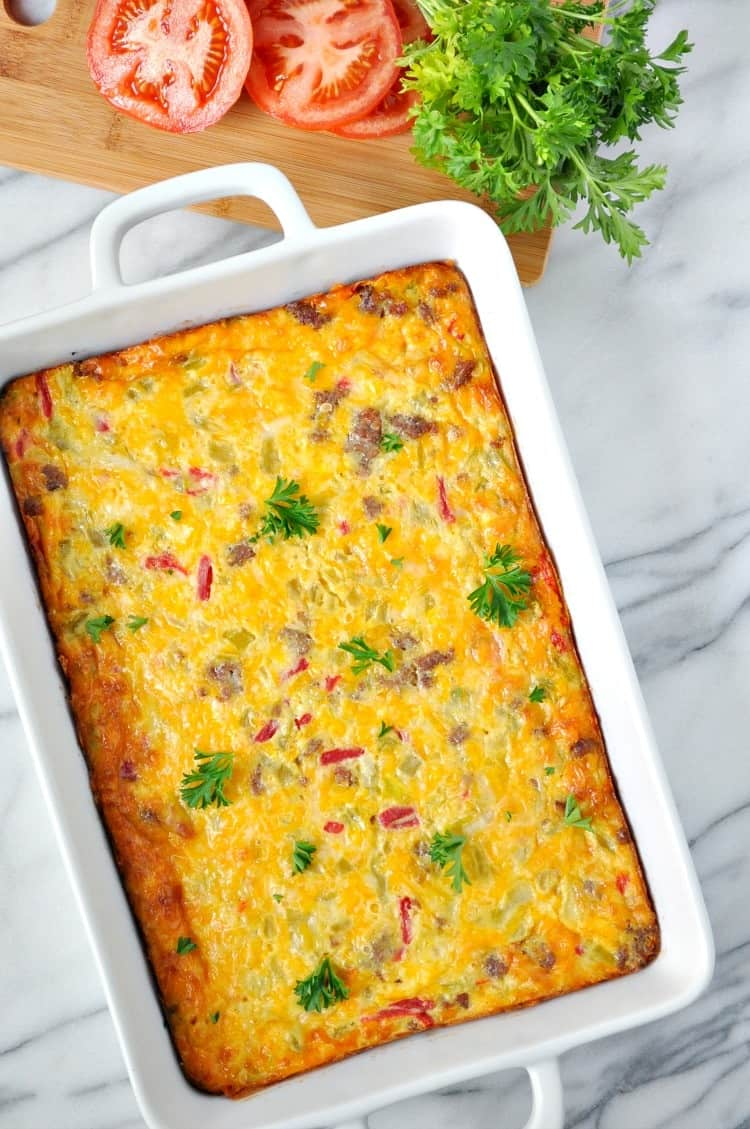 An overhead shot of a casserole dish filled with sausage and cheese squares