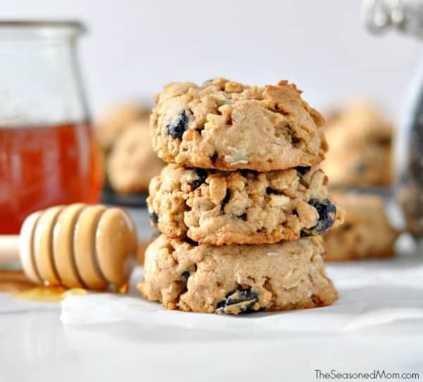 A close up of healthy trail mix cookies stacked on top of each other