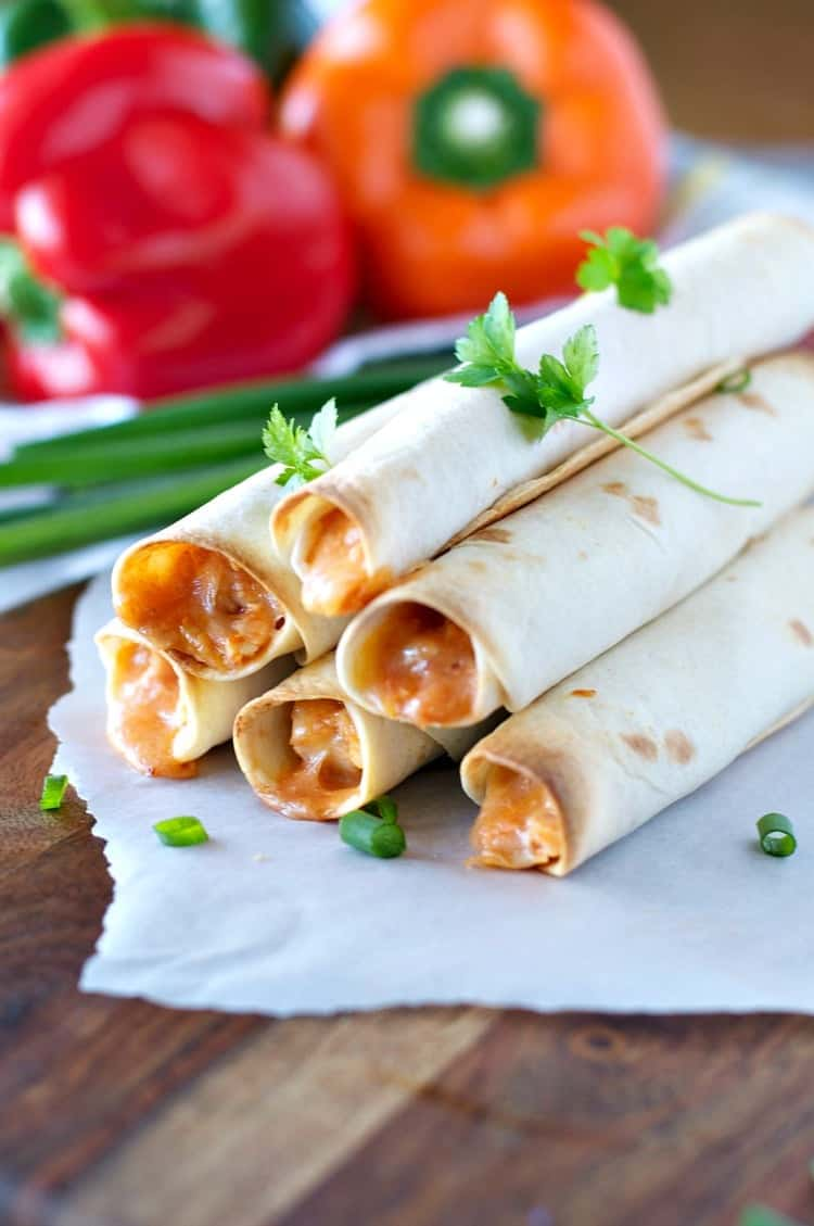 A close up of chicken taquitos
