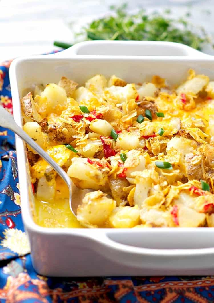 Cheesy roasted potatoes, pimentos, and a crunchy crumb topping make Mom's Cottage Potatoes a simple and classic Southern side dish!