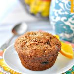 Morning Glory Muffin on a white plate with orange garnish
