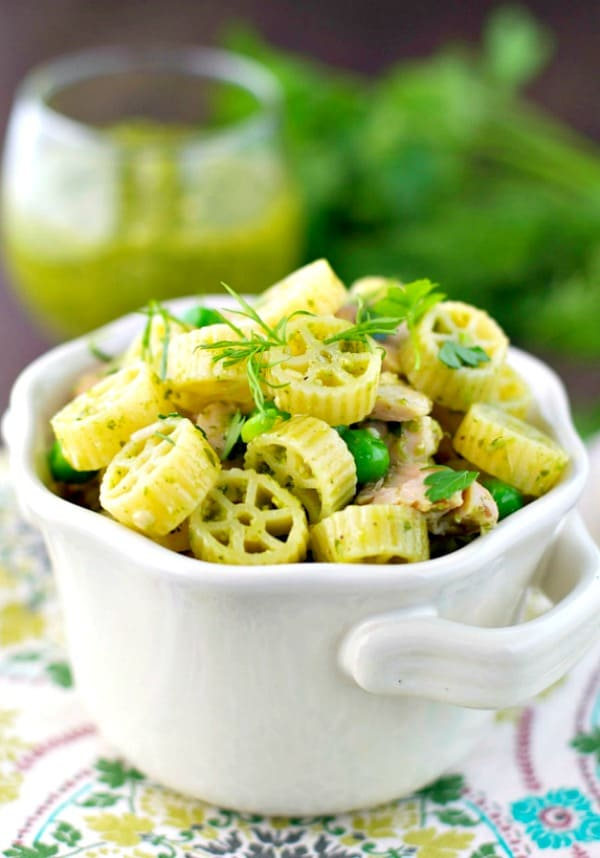 Pesto pasta in a white serving bowl