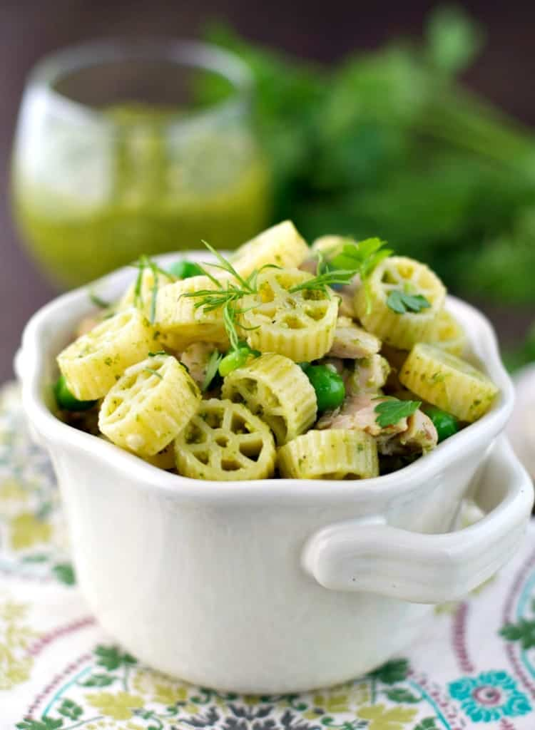 A close up of spring pasta in a white bowl