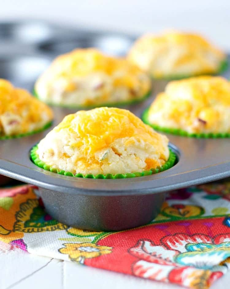 A close up of cheese and chive bacon muffins in a muffin pan