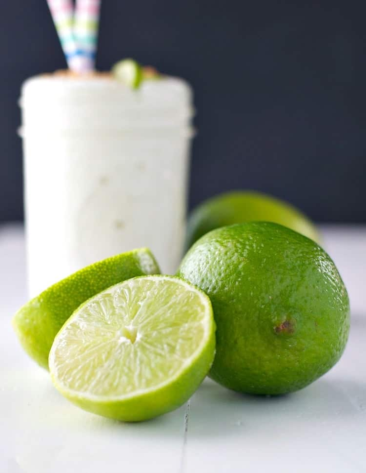 A close up of cut limes used to make an easy key lime pie smoothie