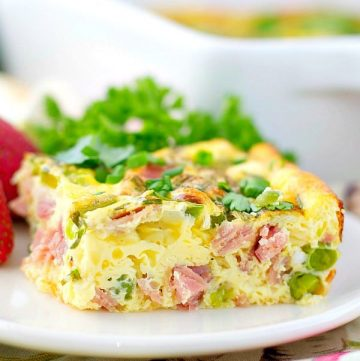 Baked omelet with spring vegetables on a white plate