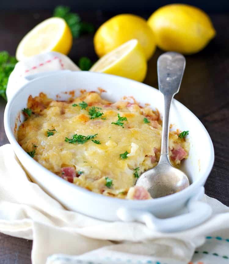 A side shot of a chicken and rice cordon bleu casserole