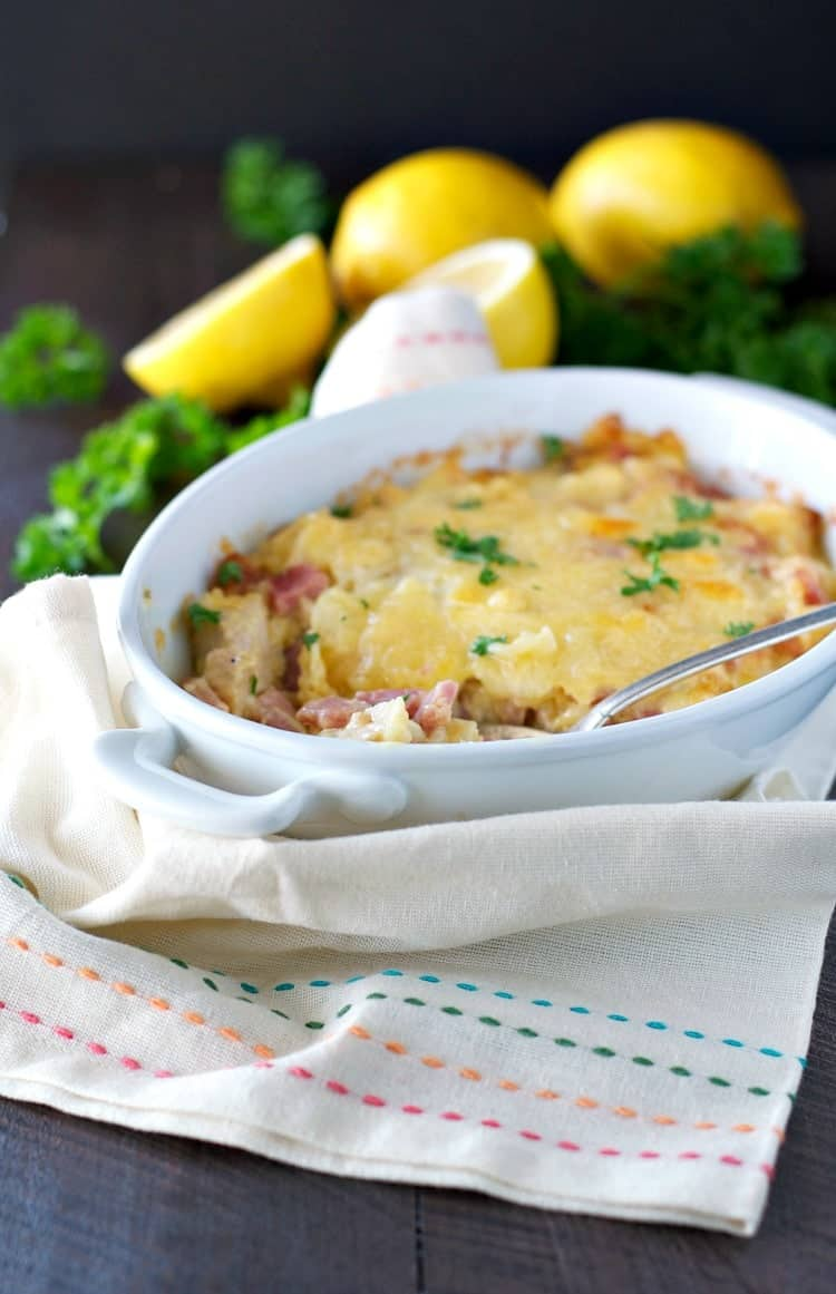 A side shot of a cordon cleu casserole in a white dish