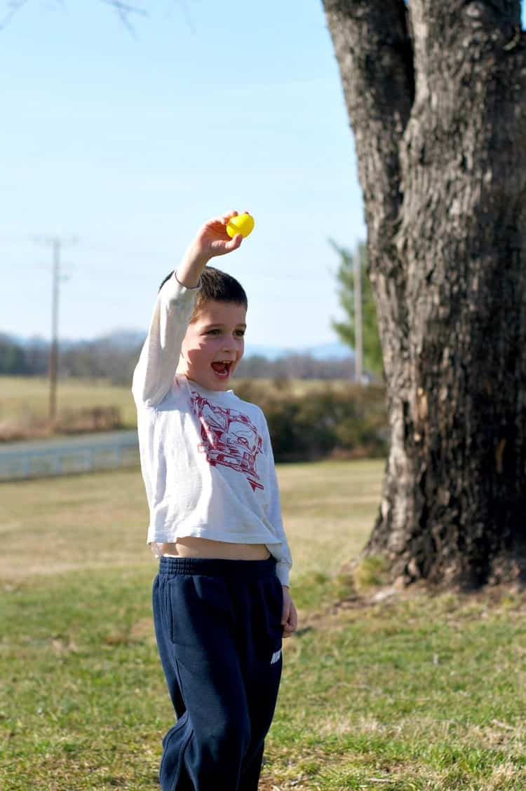 An Easter Egg Snack Toss is an easy Easter Game for Kids -- and it will keep the youngsters active and energized throughout the holiday!