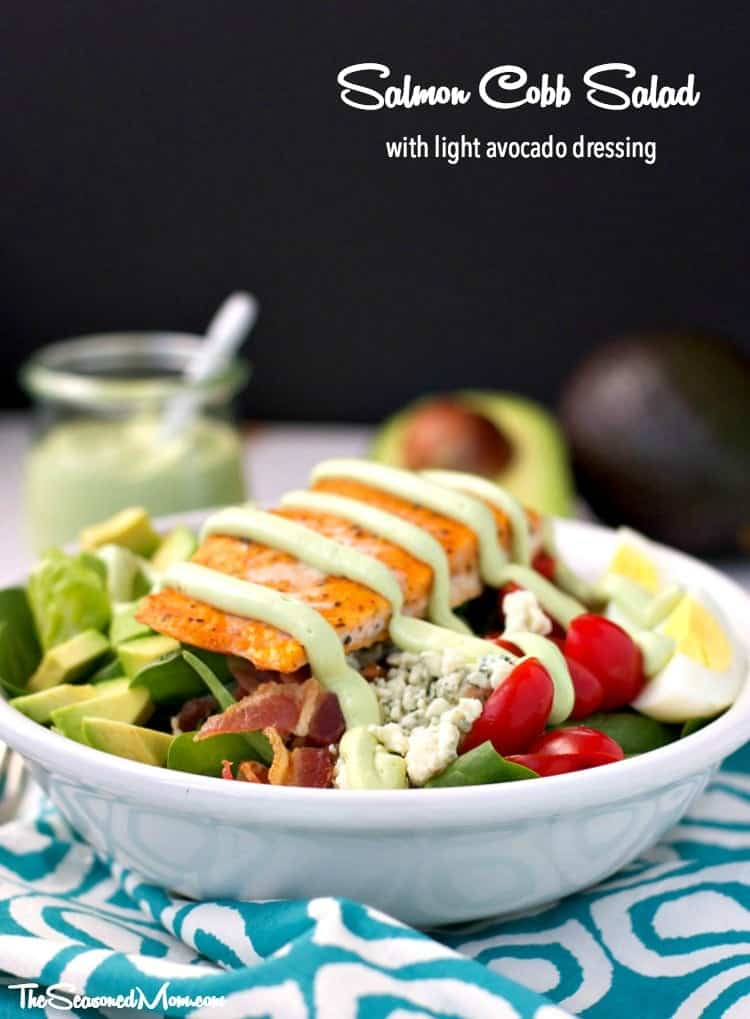 A salmon cobb salad with avocado dressing in a bowl