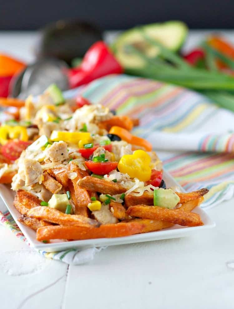 A close up of loaded sweet potato fries