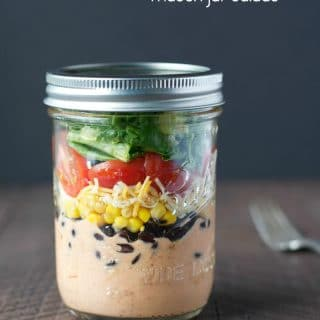 A chicken taco salad in a mason jar