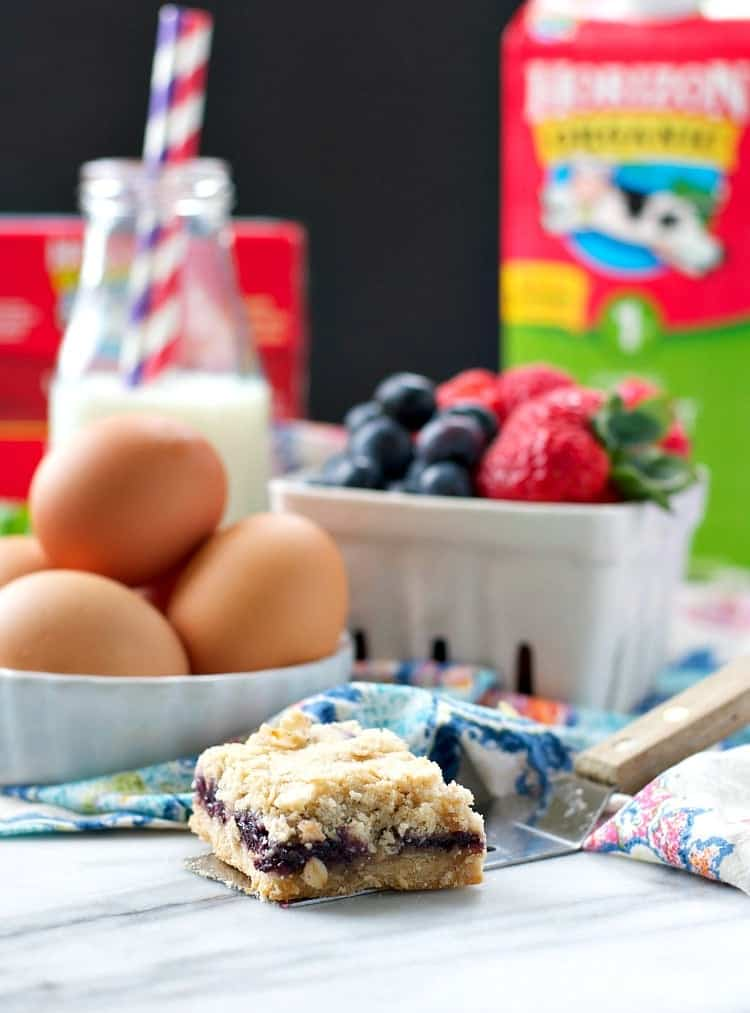 Ingredients for making blueberry muffin bars and one on a spatula