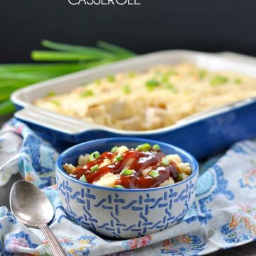 A chicken and grits casserole in a blue bowl