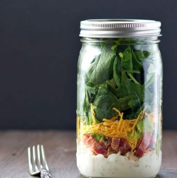 A chicken and bacon ranch salad in a mason jar