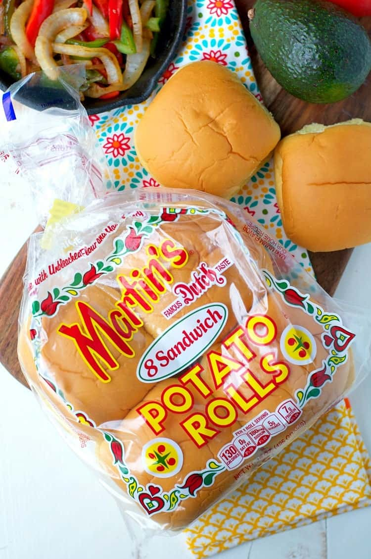 A packetg of Martin's potato rolls with ingredients for a chicken fajita burger at the side