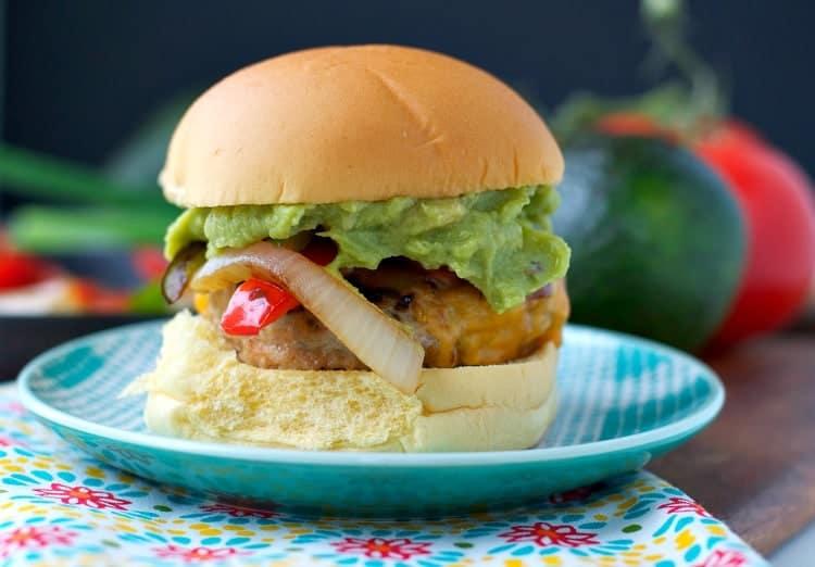 A close up of a chicken fajita burger