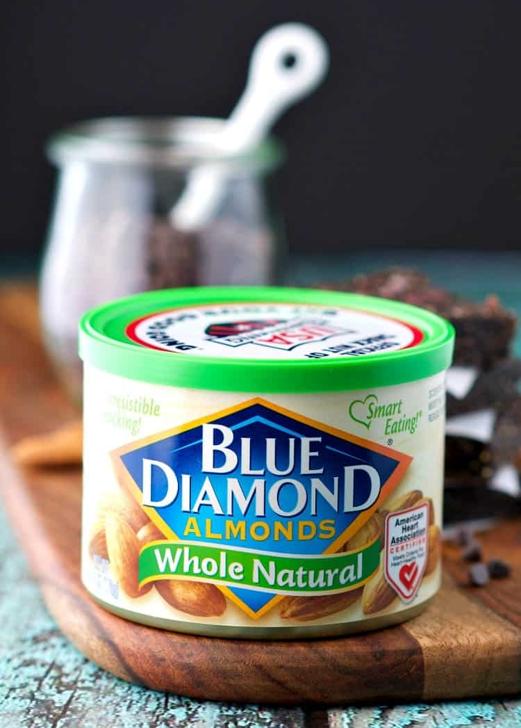 A photo of blue diamond almonds in a can with homemade energy bars in the background
