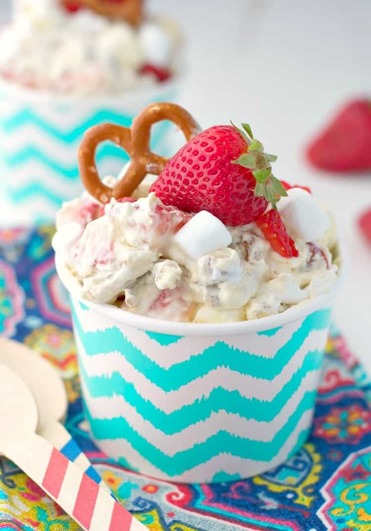 This salty, sweet, creamy, and crunchy Strawberry Pretzel Fluff is sure to be the hit at all of your summer parties! It's an easy 10-minute dessert salad that disappears FAST at any potluck, picnic, cookout, or other festive gathering!