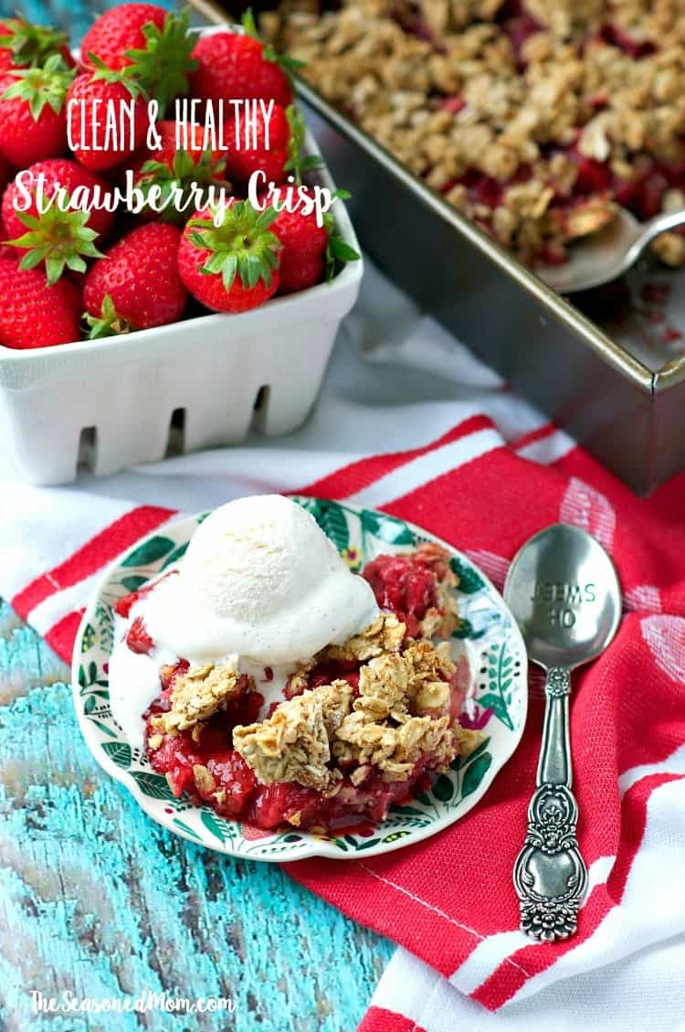 Fresh strawberries, whole grain oats, and crunchy almonds make this Clean and Healthy Strawberry Crisp an easy make ahead breakfast or low calorie dessert to enjoy all summer long! It's gluten-free, contains no refined sugar, and uses simple, real food ingredients that you can feel good about feeding your family!
