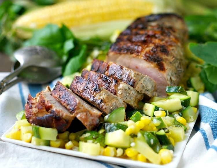 A close up of boneless pork tenderloin cut into slices